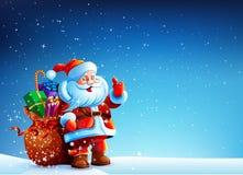 Santa Claus i snön med en påse av gåvor Arkivfoton