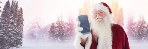 Santa Claus i vinter med telefonen Arkivbild