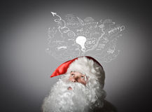 Santa Claus and ideas. Stock Photography