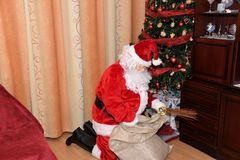 Santa Claus and Christmass tree during Xmas with happy girl. Santa Claus incoming home during holiday Christmass tree during Xmas with happy girl decoration Stock Image