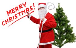 Santa Claus, inscription Merry Christmas and green tree. On a white background, isolated royalty free stock image