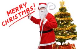 Santa Claus, inscription Merry Christmas and green tree. On a white background, isolated stock images