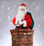 Santa Claus Inside Chimney Snowy Background Fotos de archivo