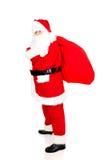 Santa Claus intégrale avec le sac plein des présents Images libres de droits