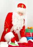 Santa Claus ironing clothes. Stock Photo