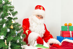 Santa Claus ironing clothes. Stock Images