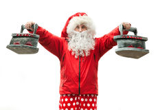 Santa Claus with the irons Stock Photography
