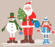 Santa Claus, jeune fille de neige et bonhomme de neige Photos stock