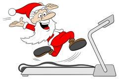 Santa Claus joggar på en trampkvarn Royaltyfri Foto