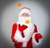 Santa Claus is juggling. Stock Photos