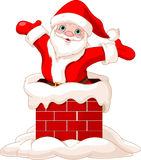 Santa Claus jumping from chimney Stock Photo