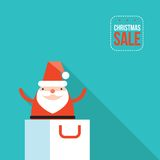 Santa Claus jumping out of shopping bag Christmas sale New Year presents Royalty Free Stock Photo