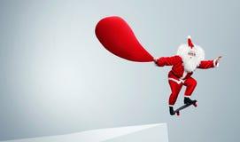 Santa Claus jumping with skateboard Stock Photo