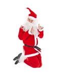 Santa Claus jumping with thumb up sign stock photos