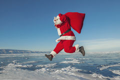 Santa Claus jumping in the winter Stock Images