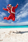 Santa Claus jumps on beach Royalty Free Stock Image