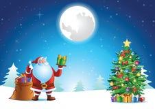 Santa Claus kciuk up przy xmas nocą i przedstawienie prezent obrazy stock