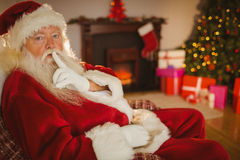 Santa claus keeping a secret Stock Photo