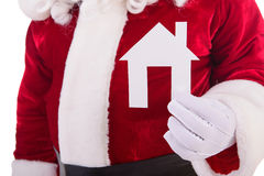 Santa Claus keeps paper house Royalty Free Stock Images