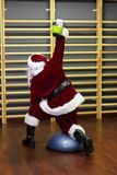 Santa Claus kettlebells training Stock Images