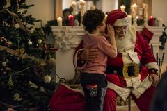 Santa claus and kid in christmas time Royalty Free Stock Images