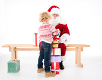 Santa Claus with kid and gift boxes Royalty Free Stock Photography