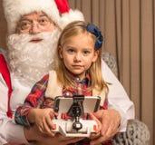 Santa Claus with kid looking at camera. Portrait of Santa Claus with kid looking at camera Stock Photo