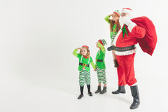 Santa Claus and Kids dressed in Elven costumes. North Pole. Stock Photos