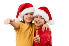 Santa Claus kids - Ok sign. Kids wearing Santa Claus hats showing thumbs up , isolated on white Royalty Free Stock Images