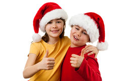 Santa Claus kids - Ok sign. Kids wearing Santa Claus hats showing thumbs up , isolated on white Royalty Free Stock Photo