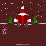 Santa Claus lê de seu livro grande Foto de Stock