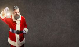 Santa Claus with a lamp on a Christmas. stock image