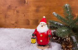 Santa Claus with lamp and snow Royalty Free Stock Images