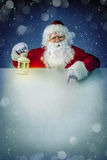Santa claus with lantern. On billboard stock photography
