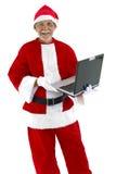 Santa Claus and Laptop Stock Photos
