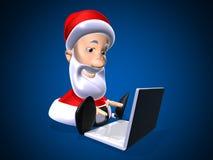 Santa Claus with a laptop Stock Photos