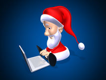 Santa Claus with a laptop Royalty Free Stock Photo