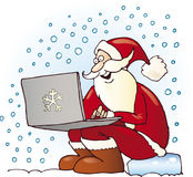 Santa claus with laptop. On snow Stock Photos