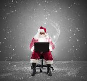 Santa Claus with laptop Royalty Free Stock Photography