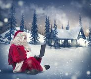 Santa Claus with laptop Stock Image