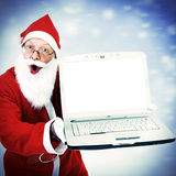 Santa Claus with Laptop Stock Photography