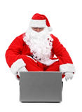 Santa claus with laptop Royalty Free Stock Photos