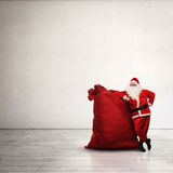 Santa Claus with large red sack Royalty Free Stock Images