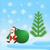 Santa claus with the large sack of gifts идет on a path Royalty Free Stock Images
