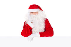 Santa Claus leaning on blank board Royalty Free Stock Images