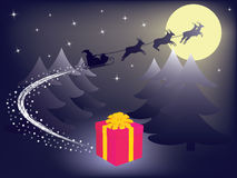 Santa Claus leaving gift Royalty Free Stock Photos