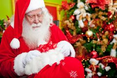 Santa Claus leaving gifts Stock Photos