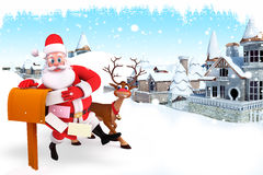 Santa claus with letter box and reindeer Royalty Free Stock Image