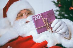 Santa claus with letter in hand Stock Image