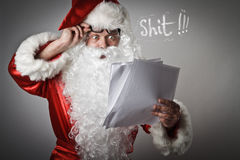 Santa Claus and letters. Shocked Santa Claus is reading the letters. Curse concept Stock Images
